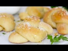 These soft, garlicky knots taste just like your favorite pizzeria's garlic knots, but made from scratch using my easy yeast-free bagel dough recipe (just flour,