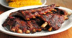 These spicy ribs are flavored with 2 chiles - chipotle chile pepper and chili powder - then sweetened with brown sugar and maple syrup. You can even bake the ribs a day ahead and grill just before serving.