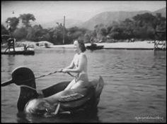 Olivia De HavillandOn a duck boat water thing.