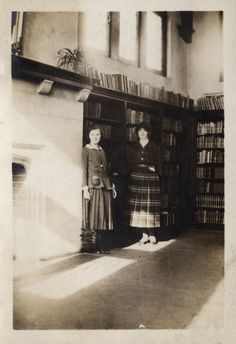 High Park Branch - Toronto Public Library - interior photo circa 1920 (twenties) showing librarians standing beside the fireplace.