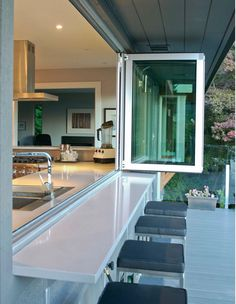 Indoor / outdoor connected bar / counter with accordion windows