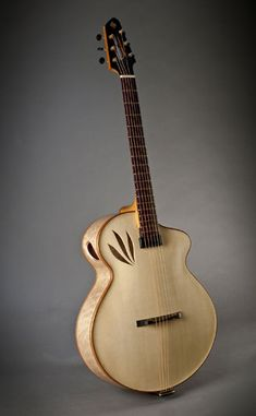 "Imperial by Erich Solomon. cutaway archtop guitar with nature inspired ""leaf"" soundholes. Hand carved European spruce top with X bracing. Hand carved curly European maple back and sides. Hand made by luthier Erich Solomon Jazz Guitar, Guitar Art, Music Guitar, Cool Guitar, Banjo, Ukulele, Unique Guitars, Custom Guitars, Vintage Guitars"