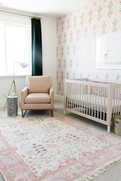 Gorgeous baby girl's nursery with blush pink tones and deep emerald green hues