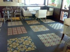 another nice way to use more than one encasutic tile pattern - inlay them into a border of plain dark tiles!