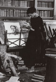 Gianni Versace Collezione Uomo A/W 1996/'97.  Library, paintings, desk, long black dress. By Bruce Weber
