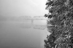 bridging the coosa,the coosa river,childersburg al,childersburg alabama,talladega county,trestle bridge,railroad bridge,railroad bridges,fog on the river,fog,foggy,country,jc findley,black and White
