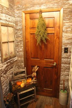 Primitive barn wood wall in my foyer. Put old window up with grandma's pillow case and doilies behind to look like a curtain..decorated with tool box and old chair.
