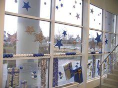 оформление витрины магазина звездочками на Новый год