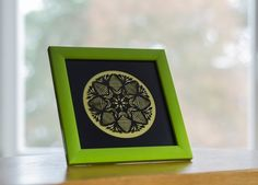 A Kurpie star - hand made and framed in green