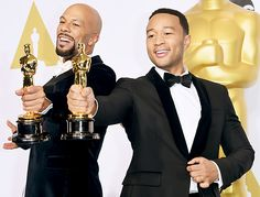 Oscar winners John Legend and Common proudly held up their Oscar statues after their Best Original Song win at the 87th Academy Awards on Sunday, Feb. 22.