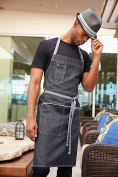 The Memphis Bib Apron keeps you structured and organized. The comfortable and stylish Memphis Bib Apron is made with cotton denim and criss-cross bar tacks to tackle a heavy-duty workload. Cafe Uniform, Waiter Uniform, Hotel Uniform, Bartender Uniform, Housekeeping Uniform, Cafe Apron, Bib Apron, Apron Dress, Work Uniforms
