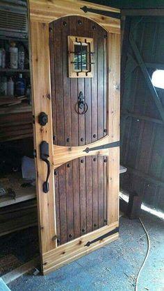 Rustic wood door with rivets