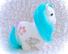 A gorgeous G1 So Soft Cupcake pony from the 80s! Beautiful shape with minimal deflocking. Some yellow spots on non-display side. Comes with original matching ribbon!  Please see all pictures up close for a thorough representation! :) I have TONS more cute vintage items for sale in my Etsy shop - check it out for super cheap shipping discounts!  I ship WORLDWIDE from a clean, pet & smoke-free home! Please note that shipping times will be slower OUTSIDE of the US & Canada (up to 3 months)…