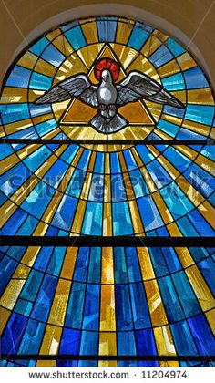 Shown is the Holy Spirit | Stained glass window in a medieval church showing the dove ...
