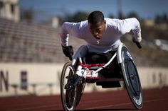 Cpl. Anthony McDaniel races around the track during practice for the 2012 Warrior Games at Colorado Springs, CO. McDaniel suffered a bilateral leg amputation and partial hand amputations from an improvised explosive device in Afghanistan 2010. He is competing in track and wheelchair basketball. The Warrior Games is a competition between wounded warriors from all military branches and includes swimming, track and field, cycling, shooting, archery, sitting volleyball, and wheelchair…