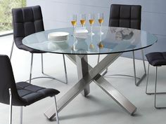 "ESF 951 Dining Table - Ovale Dining table with glass top and metal leg. Dimensions: 53""x 53""x 30""."