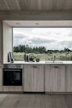 All wooden kitchen with fantastic views out to the landscape