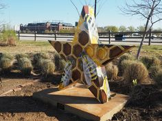 """More than 20 stars -- """"Stars of Texas"""" with various artistic interpretations -- are part of ongoing public art displays in Arlington, including this work, """"Bee Active"""" by Amy Stephens. It's on the Sculpture Trail along the east side of Johnson Creek between Cowboys Way and Randol Mill Road. The Arlington Museum of Art sponsored the collaboration."""