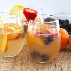 Berry Peach Sangria Ingredients (Serves 6-8) 1 (750 mL) bottle white wine {fruity is best, like Sauvignon Blanc or Pinot Grigio} 2 oz. (1/4 cup) orange liquor {like Triple Sec, Cointreau, or Grand Marnier} 1 lemon, sliced 1 lime, sliced 1 cup blackberries 8 strawberries, sliced 16 oz. (2 cups) club soda