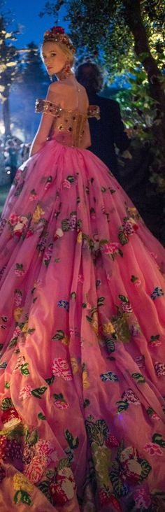 Not so sure about the pink, but sewing flowers or butterflies or something into a long tulle skirt could be good