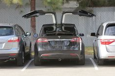 2016 Tesla Model X Falcon Wing Door. Meant to operate with ballet-style grace, these doors seem like a designer's self-indulgence at first, but then you notice the way in which they foster easier access to the rear seat by minimizing the effective width of the door sills. Sensors allow the double-hinged doors to open in two different arcs depending on the proximity of exterior obstacles, and only a foot of clearance is required.