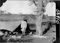 https://flic.kr/p/71SCLk | Man outside of tent | Man standing outside of expedition tent with various camping utensils. 1927.  Name of Expedition: Daily News Abyssinian Expedition Participants: Wilfred Osgood, Louis Agassiz Fuertes, C. Suydam Cutting, Jack Baum, Alfred M. Bailey Expedition Start Date:  September 7, 1926 Expedition End Date: May 20, 1927 Purpose or Aims: Zoology Mammals and Birds Location: Africa, Ethiopia [Abyssinia]  Original material: 4x5 inch interpositive film Digital…