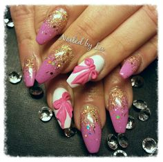 Pink and gold acrylic nails with gel polish. Coffin / ballerina shape with 3D sculpted bows