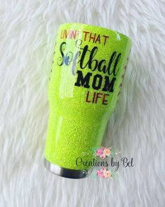 "Glitter tumbler designed with ""Livin' that softball mom life"" design, can be personalized with name or monogram also. If you would like to add or edit any part of this tumbler, please send me a message and we can work on creating your custom tumbler. Featured tumbler was created in"