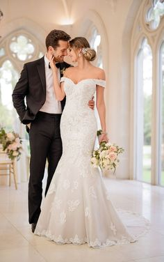 A timeless, glamorous style, this mermaid wedding dress from Stella York will complete any elegant affair! With a bold, lace pattern throughout, this classic silhouette is a nod to romantic styles of the past. A sweetheart neckline is accented perfectly with lace straps that can be worn up - in a more traditional style - or off the shoulder for a modern update. The back of this gown features sheer, lace detailing that adds a flirty element. The lace pattern continues from the bodice down…