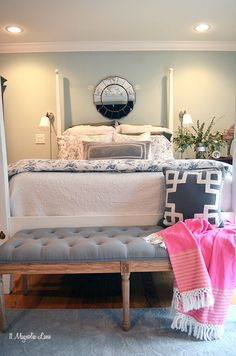 Master bedroom painted in Sherwin Williams Comfort Gray with IKEA bedding and white and dark wood furniture.