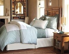 I love the shutter-style headboard.  Would be really simple to recreate without paying the $800+ that PB is asking for it.  I like the pendant lighting above the bed and that little glass candelabra makes me happy!  http://girlinair.blogspot.com/2011/02/old-shutters-headboard-tutorial.html  Thank you, Melody, for telling me how to find this tutorial!