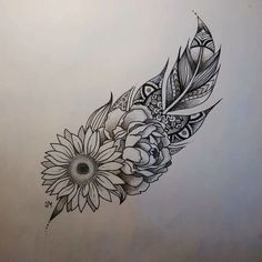 feather and sunflower, rose drawing, black and white sketch, white background, lotus mandala tattoo Mandala tattoos have taken the world by storm. What is their symbolism? Read our article to find out the real meaning and beauty of a mandala tattoo.