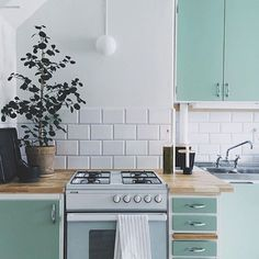 Some kitchen inspo to end your week with. I never thought I'd find myself drawn to mint cabinetry but it's pretty breathtaking, right? Image via @kvart_joanna #kitchen #kitcheninspo #kitchendesign #kitchencabinet #kitchencabinets #kitchenideas #kitchendecor #kitchenstyle #tiles #subwaytiles #kitchentiles #splashback