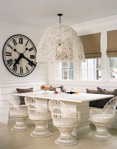 Built in Breakfast room: This cool, modern fixture is made from a wire boxwood shrub trainer. Painted white, the design echoes the vintage fiberglass dining chairs. An oversized wall clock balances the large size of the fixture. Cottage Living Magazine, Cottage Renovation, Amber Interiors, Modern Cottage, Wicker Furniture, Wicker Dresser, Wicker Mirror, Wicker Tray, Wicker Table