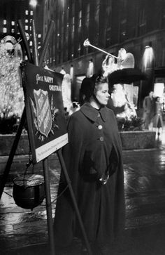 1954: Young Salvation Army volunteer soliciting Christmas-time contributions at Rockefeller Center. (Photo by Peter Stackpole//Time Life Pictures/Getty Images)
