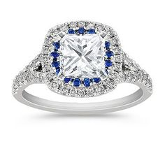 This unique engagement ring, as part of our Legacy collection,  features 48 round pavé-set diamonds, at approximately .47 carat TW and is accented with 19 round sapphires, at approximately .21 carat TW.  The combination, crafted in quality 14 karat white gold, is breathtaking at approximately .68 carat total weight.  Simply add the center stone of your choice at approximately 1.00 carat. Please contact a customer service representative for additional information or questions regarding your…