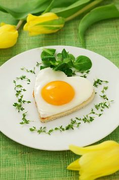 Lovely heart shaped Fried Eggs on Toast for Valentine's, St. Patrick's Day, Easter - or any time you fancy. #food #eggs #Easter #breakfast