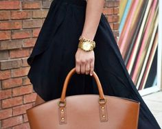 love the oversize camel bag and the layered wrist flair