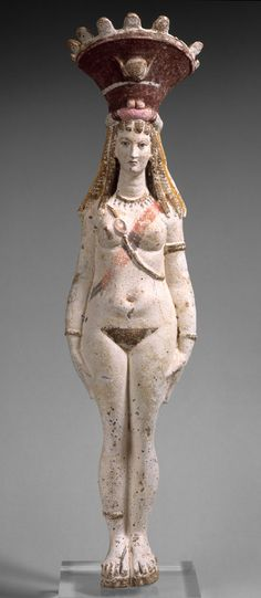 Terracotta Figure of Isis-Aphrodite, Roman period, 2nd–3rd century Egyptian Alluvial clay; brown, black, red, and pink paint on white englobe H. 19 1/2 in. (49.5 cm) | The Metropolitan Museum of Art