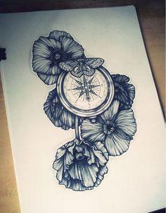 a clock that has beautiful flowers beneath it and a butterfly