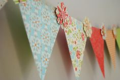:)  PLEASE VOTE - If you could pick what style of banner to make at MOPS...Would your prefer a HOLIDAY (Fall, Christmas, etc), BIRTHDAY (primary colors), or an EVERYDAY DECOR (similar to pictured)?  Thanks!      Paper Pennant Garland - Using brads and die-cut flowers to secure together. (There are scallop pennant and several flower die cuts at Ben Franklin, Monroe, WA)