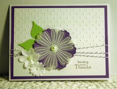 Stamps: SU Petite Pairs and Mixed Bunch  Paper: Cardstock: SU Whisper White, Vellum, Lovely Lilac (retired). Green paper leaves from printed paper scrap.  Ink: SU Lovely Lilac (ret)  Accessories: SU Blossom Punch, Wisteria Wonder Baker's Twine (ret.), Basic Pearls, white embossing powder. Perfect Polka Dots Embossing folder.  Techniques: Heat embossing