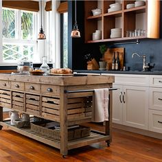 Stone Top Double Kitchen Island...Not only is this a fabulous kitchen island from Williams Sonoma. Also love the kitchen design!  <3 Clean lines with a rustic touch.