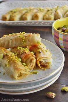 Phyllo Ashta Fingers An elegant phyllo dessert garnished with chopped pistachios and drizzled with simple syrup. Layers or buttery phyllo wrapped around creamy custard Ashta and baked to a perfect crunch. Lebanese Desserts, Lebanese Cuisine, Lebanese Recipes, Indian Desserts, Phyllo Dough Recipes, Pastry Recipes, Dessert Recipes, Cooking Recipes, Tofu Recipes