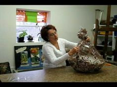 Learn how to wrap a gift basket with cello in this video.