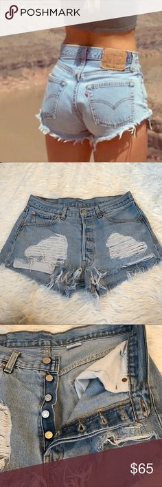 """Lightwash levis 501 distressed cutoff shorts These are actually from urban outfitters/ but they remind me so much of the furst of a kind style!! LF listed for views. 15.5"""" laying flat. Can be worn on a smaller waist for the baggy boyfriend look (personal favorite). High waisted and distressed to perfection. Open to offers! LF Shorts Jean Shorts"""