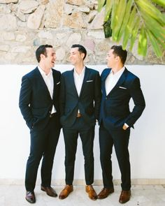 """The groomsmen (aka the """"best men"""") sported Hugo Boss suits and white linen pocket squares, a gift from the couple."""