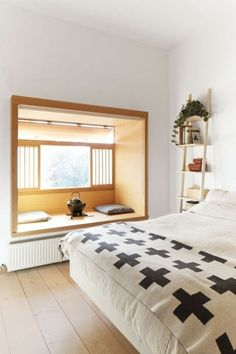 very cool Toronto apartment Unique window seat adds personality to this bedroom.Unique window seat adds personality to this bedroom. Toronto Apartment, Interior, Home, Home Bedroom, Bedroom Interior, Scandinavian Home, House Interior, Japanese Bedroom, Interior Design