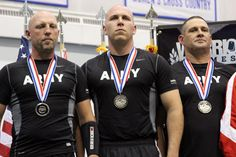 Jason Steele (center), a Soldier assigned to Warrior Transition Unit at Joint Base Langley-Eustis, Va., earned a  Silver Medal May 2, 2012, in the team Composite Bow archery event during the 2012 Warrior Games. Steele medaled in his first Warrior Games competition. (Craig Coleman)