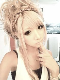 like the long piece of hair in front but other than that. makeup and hair are awesome(: